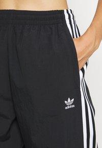 adidas Originals - TRACK PANTS - Spodnie treningowe - black - 4