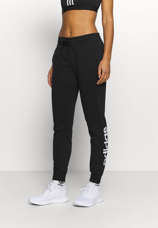 PANT - Verryttelyhousut - black/white