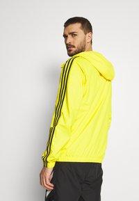 adidas Performance - BASIC 3 STRIPES WINDBREAKER - Outdoorjacka - yellow - 2