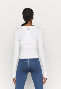 Puma - PAMELA REIF X PUMA COLLECTION RUSHING - Sports shirt - star white - 2