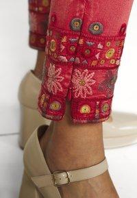 Desigual - PANT DELFOS - Slim fit jeans - red - 7