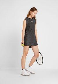 adidas Performance - DRESS SET - Sportovní šaty - black/glow green - 1