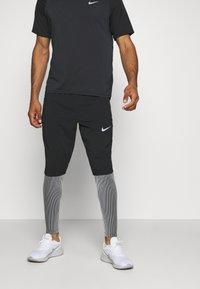 Nike Performance - ELITE - Pantalones deportivos - black/reflective silver - 0