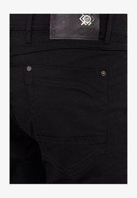 Cipo & Baxx - CASUAL SUMMER MIT REISSVERSCHLUSS - Slim fit jeans - black - 1