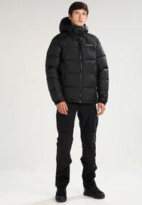 Columbia - PIKE LAKE HOODED JACKET - Winter jacket - black - 1