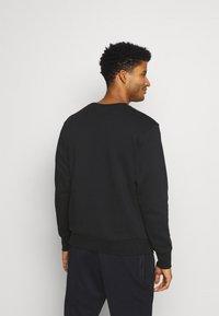 Nike Performance - NBA TEAM  WASH PACK CREWNECK - Sweatshirt - black - 2