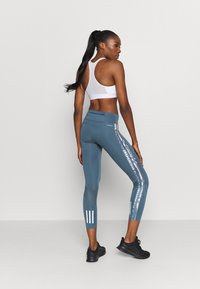 adidas Performance - OWN THE RUN - Tights - legblu/hazcor - 2