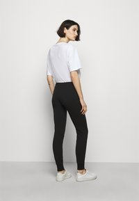 Love Moschino - Spodnie treningowe - black - 2