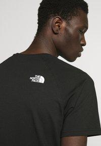 The North Face - RAGLAN TEE  - Print T-shirt - black/white - 5