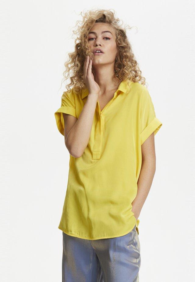 Paitapusero - yellow