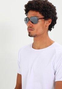 Prada Linea Rossa - LIFESTYLE - Sunglasses - gunmetal/light grey mirror black - 1