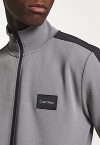 Calvin Klein - SOLID MIX BACK LOGO JACKET - Summer jacket - grey - 6