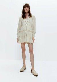 Uterqüe - Robe chemise - white - 1