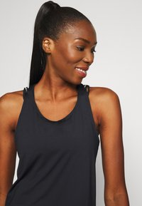 Under Armour - SPORT X BACK TANK - Sports shirt - black