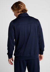 Nike Performance - M NK RIVALRY TRACKSUIT - Dres - obsidian/black - 2