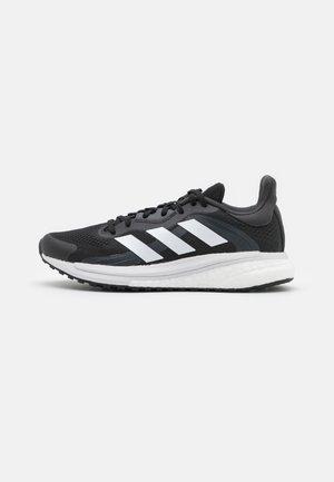 SOLAR GLIDE 4 ST  - Stabiliteit hardloopschoenen - core black/footwear white/grey six