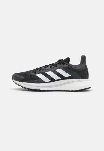 SOLAR GLIDE 4 ST  - Stabilty running shoes - core black/footwear white/grey six