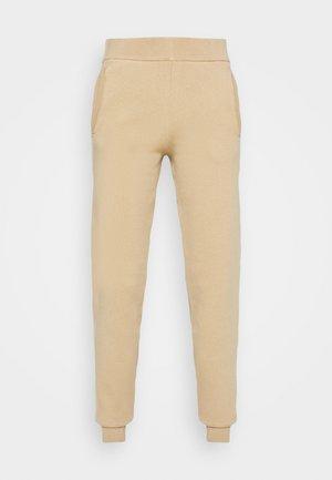 PORTAL - Tracksuit bottoms - camel