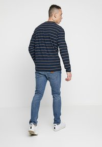 Carhartt WIP - REBEL PANT SPICER - Jeansy Slim Fit - blue mid - 2