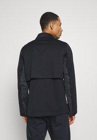 Nike Golf - HYPERSHIELD RAPID ADAPT 2-IN-1 - Waterproof jacket - black/dark smoke grey - 2