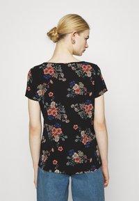 Vero Moda - VMSAGA - Camiseta estampada - black - 2