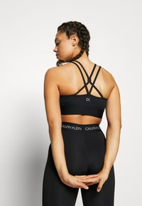 Calvin Klein Performance - LOW SUPPORT BRA - Sport BH - black - 2