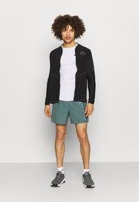 Nike Performance - Sports shorts - hasta/black - 1