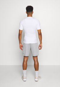 Nike Performance - Basic T-shirt - white - 2