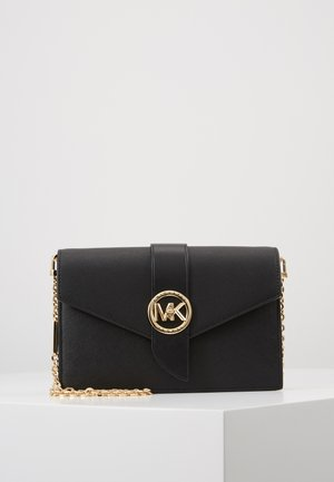 CHARMMD XBODY - Clutches - black