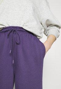Topshop - HARLEY JOGGER - Tracksuit bottoms - plum - 4