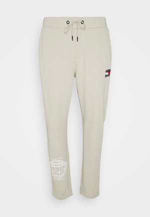 ONE PLANET UNISEX - Tracksuit bottoms - sand
