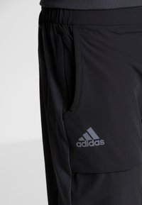 adidas Performance - Tracksuit bottoms - black - 7