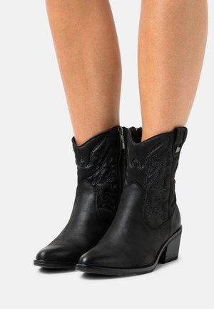 TANUBIS - Cowboy/biker ankle boot - black