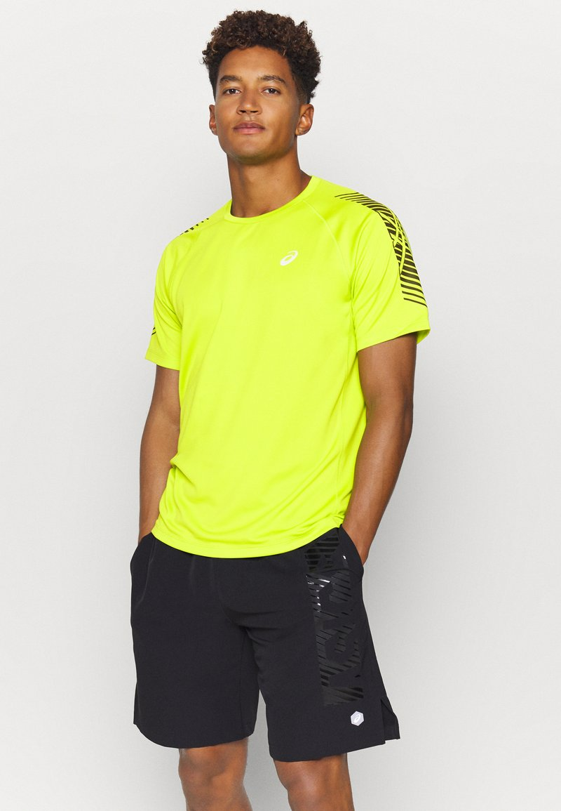 ASICS - ICON - T-shirt con stampa - lime zest/performance black