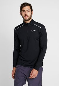 Nike Performance - T-shirt de sport - black/reflective silver - 0