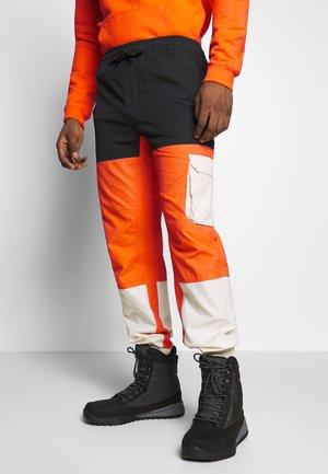 SAMUEL - Trousers - orange zest