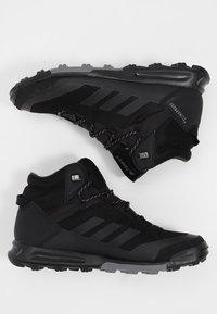adidas Performance - TERREX TIVID MID CLIMAPROOF HIKING SHOES - Obuwie hikingowe - black - 1