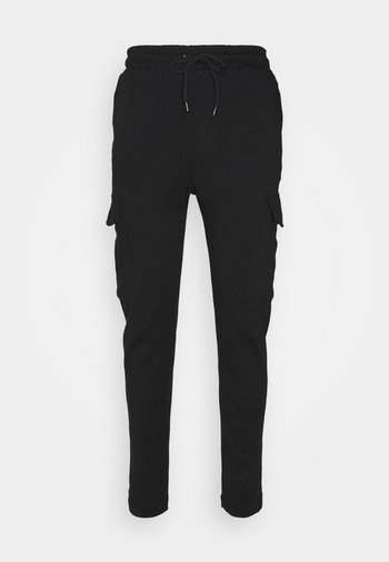 ROCKERPLAIN - Reisitaskuhousut - black