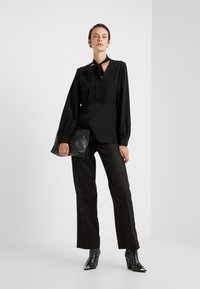 McQ Alexander McQueen - Trousers - black/red - 1