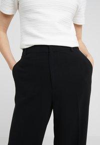 Filippa K - HUTTON TROUSERS - Trousers - black - 4