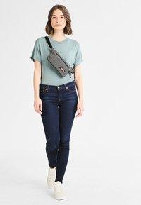 Eastpak - TALKY/CORE COLORS - Bum bag - black denim - 0