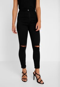 Missguided Petite - VICE HIGHWAISTED SLASH KNEE - Jeans Skinny Fit - black - 0