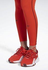 Reebok - STUDIO LUX PERFORM LEGGINGS - Legging - red - 5