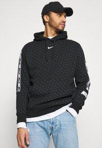 Nike Sportswear - REPEAT HOOD - Sweatshirt - black/white - 3