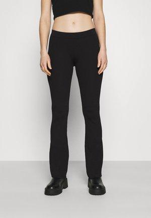 ORINA TROUSERS - Trousers - black