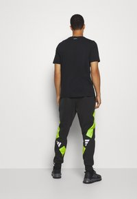 adidas Performance - URBAN PANT - Tracksuit bottoms - black/neon green - 2