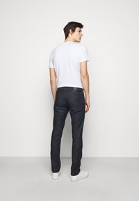 Emporio Armani - POCKETS PANT - Slim fit jeans - dark blue denim - 2