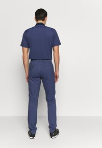 Under Armour - TAKEOVER GOLF PANT TAPER - Chino kalhoty - blue ink - 2