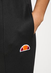 Ellesse - ADALINA - Tracksuit bottoms - black - 6