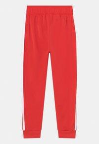 adidas Originals - UNISEX - Verryttelyhousut - red/white - 1